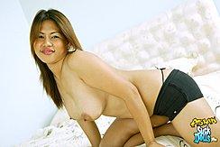 Kneeling On Bed Topless Long Hair Big Breasts Wearing Shorts