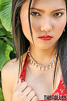 long black hair intense look playing with red dress
