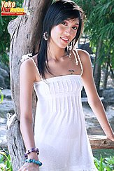 Standing On Porch Long Hair Over Her Shoulder Wearing White Dress