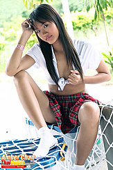 Seated On Box Wearing White Shirt Plaid Skirt Long Hair Ankle Socks