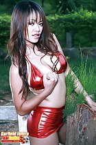 Wearing red latex bra and skirt long hair