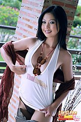 Lin Si Yee Pulling Her Top Taut Over Her Breasts