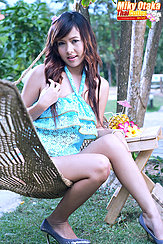 Sitting On Hammock Playing With Her Long Hair Wearing High Heels