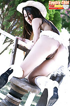 Kneeling on wooden seat pussy exposed wearing white boots