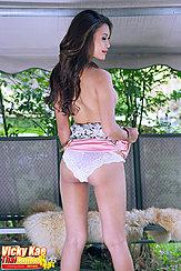 Raising Dress Exposing Her Panties Long Hair Down Her Back