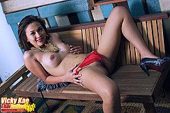 Lying On Her Back Topless Legs Open In Red Panties Wearing High Heels