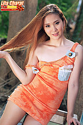 Lita Charat Playing With Her Long Hair Strap Of Dress Falling From Her Shoulder