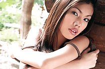 Breasty babe May Supha stripping naked outside cabin
