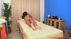 Raya Lying On Massage Table Bare Feet