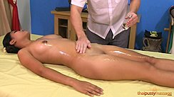 Lying On Her Back Masseur Spreading Massage Oil Over Her Body Shaved Pussy