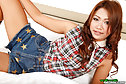 Fon stripping check shirt and denim skirt on bed