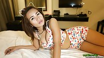 Jeaeb lying on bed wearing flowered top in shorts