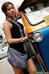 Standing Beside Tuktuk Bag Draped Over Her Shoulder