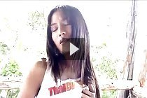 Donut Manatchanok strips outdoors and plays with lotion